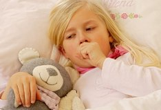 photolibrary_rm_photo_of_girl_coughing_in_bed